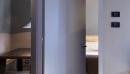 porte per hotel porta rasomuro con telaio in legno laccata